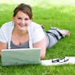 Woman with laptop and books outdoors — Stock Photo