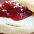 Bagel with cream cheese and preserves - Stock Photo