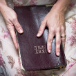 Hands Holding Bible — Stock Photo
