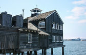 Old maritime building on piles — Stock Photo