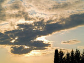 Sun Behind Yellow Clouds — Stock Photo