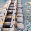 Stock Photo: Old Rusty Continuous Tracks