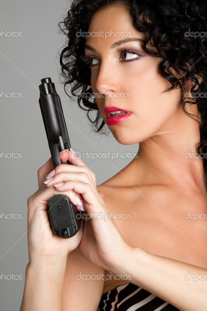 Sexy woman holding gun — Stock Photo #2374330