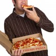 Stock Photo: MEating Pizza
