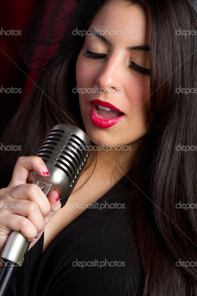 Woman singing into vintage microphone — Stock Photo #2401093
