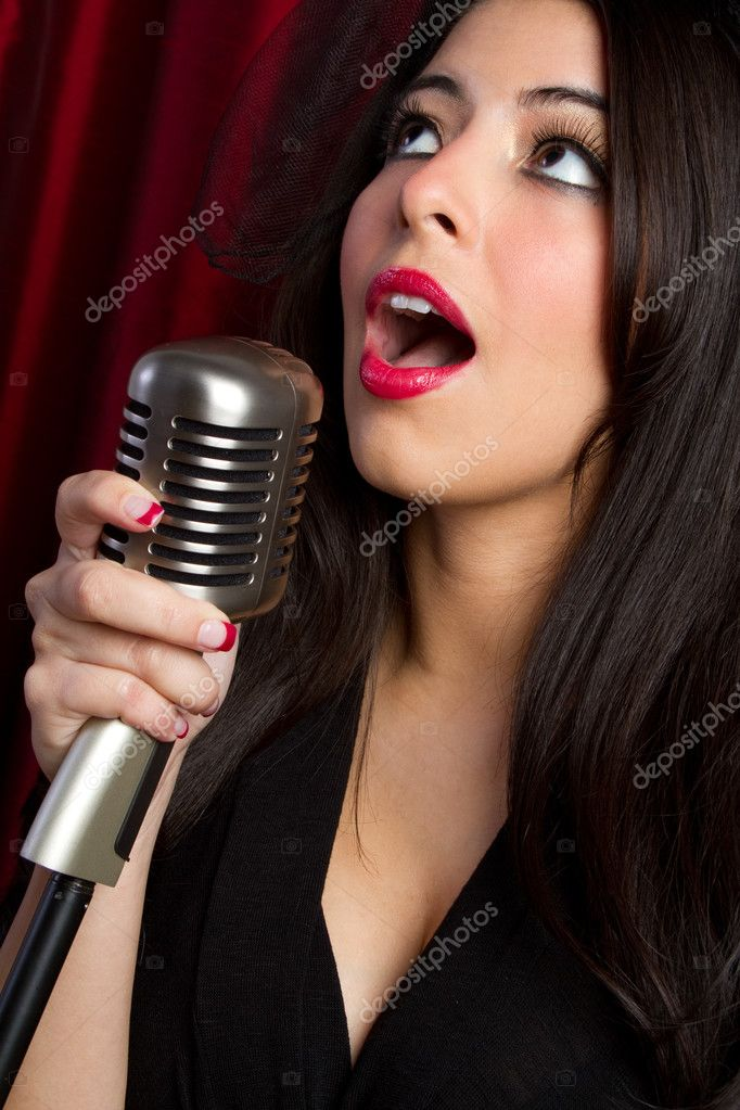 Woman singing into vintage microphone — Stock Photo #2401096