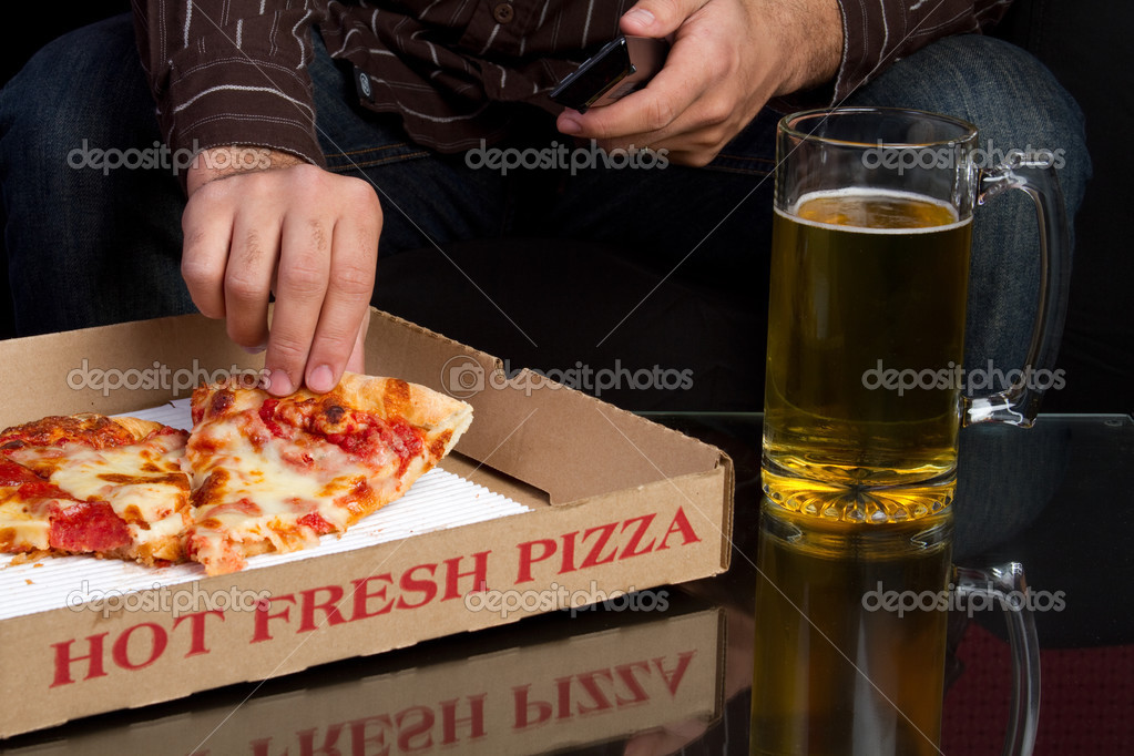 Man with pizza and beer — Stock Photo #2401129