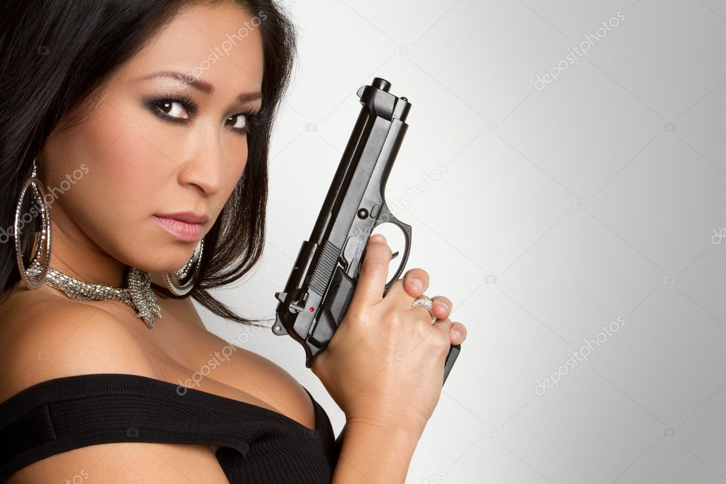 Beautiful asian woman holding gun — Stock Photo #2401182