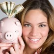 Foto Stock: WomHolding Piggy Bank