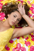 Girl in Flower Petals — Stock Photo
