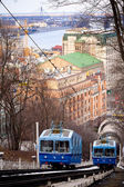 Two funicular trains moving on the hill — Stock Photo