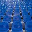 Blue chairs in a stadium — Stock Photo