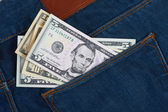Money in the pocket blue jeans — Stock Photo