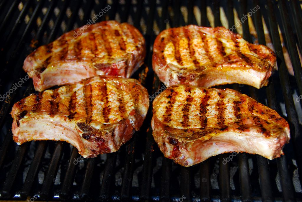 Tasty Barbecue Pork chops on a grill — Stock Photo #2304242