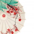 Isolated half oriental umbrella — Stock Photo