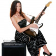 Royalty-Free Stock Photo: Sexy brunette with a guitar
