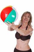 Blond women catching a beach ball — Stock Photo