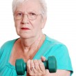 Active senior with free weight — Stock Photo