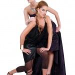 Blond and brunette women posing — Stock Photo