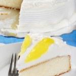 Vanilla lemon cake with a fork — Stock Photo #2385099
