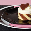White cake dessert on pink and black — Stock Photo