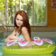 Stock Photo: Brunette womin water floating tube