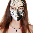 Brunette woman wearing a mask — Stock Photo