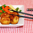 Royalty-Free Stock Photo: Chicken balls with chop sticks