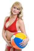 Blonde woman wearing red bikini holding — Stock Photo
