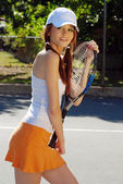 Young woman holding a tennis racket — Stock Photo