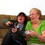 Granddaughter And Grandmother Playing Vi — Stock Photo