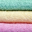 Green yellow pink towels — Stock Photo
