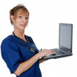 Middle aged nurse with laptop — Stock Photo