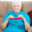 Senior woman counting knitting stitches — Stock Photo