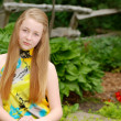 Young teen sitting in a garden — Stock Photo