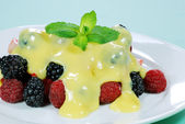 Mixed fruit with custard and mint — Stock Photo