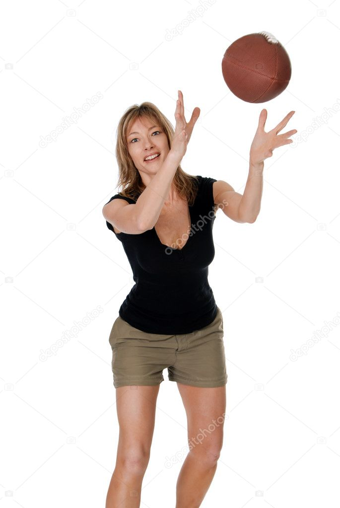 Isolated Middle aged women catching a football on white background   Stock Photo #2425923