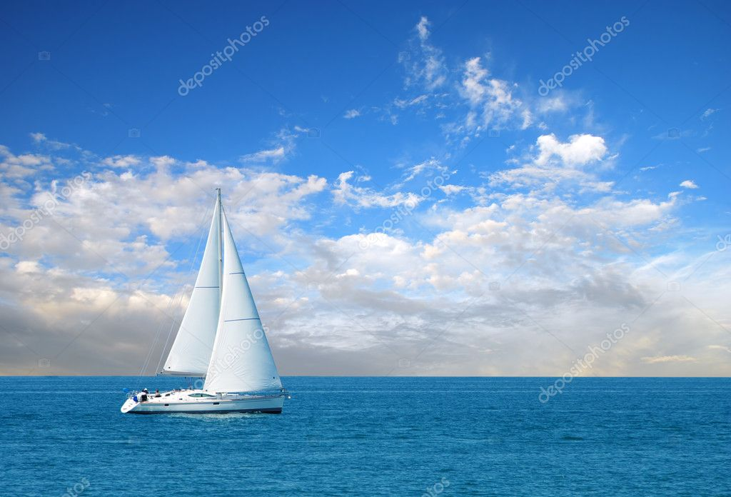 Modern sail boat on a sunny day with clouds in the sky — Stock Photo #2426103