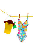 Bathing suit and toys on line — Stock Photo