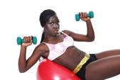 Female working out with weights ball — Stock Photo