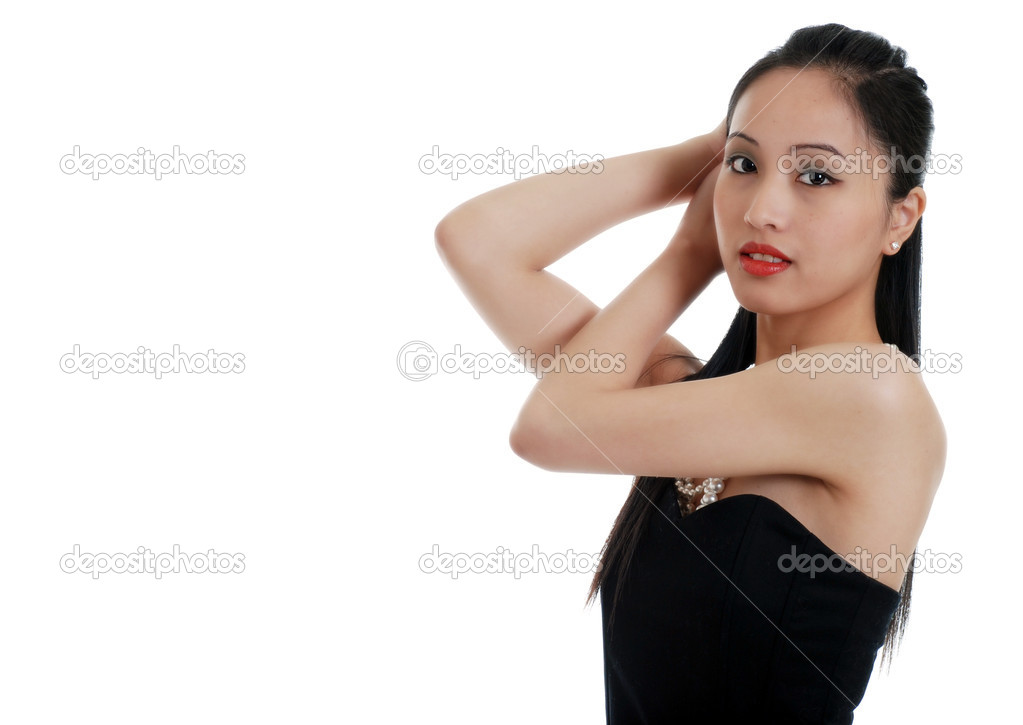 Isolated asian lady fixing her hair on white background  Stock Photo #2438329