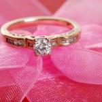 Closeup diamond ring on pink lace — Stock Photo