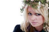 Blue eyed blond woman with laurel wreath — Stock Photo