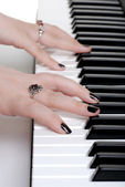 Closeup hands playing a piano — Stock Photo