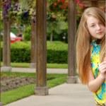 Female teenager in an outdoor garden — Stock Photo