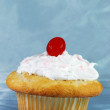 Cupcake with a cherry — Stock Photo