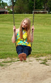 Young teen girl playing on a swing — Stock Photo