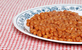 Baked beans in tomato sauce on a plate — Stock Photo