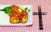 Chicken balls with chop sticks — Stock Photo