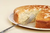 Cut lemon poppy seed cake with a fork — Stock Photo